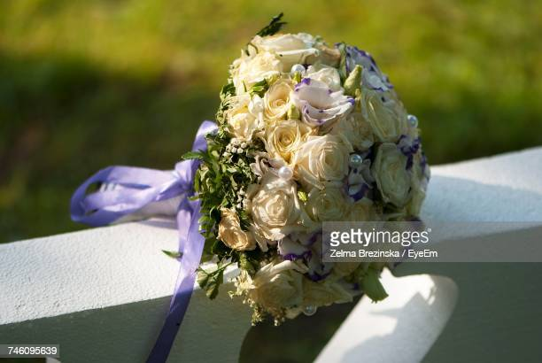 High Angle View Of Bouquet On Retaining Wall