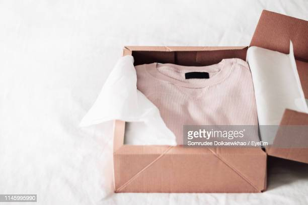high angle view of box on bed at home - clothing stock pictures, royalty-free photos & images