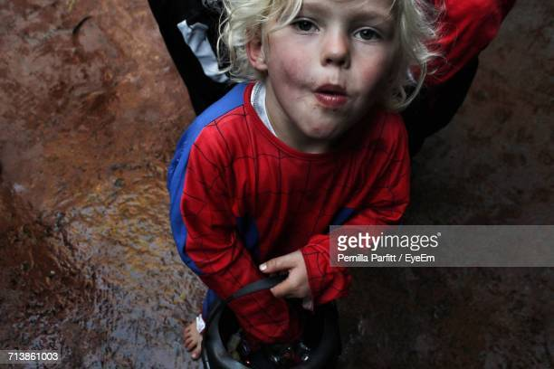 high angle view of boy dressed as spiderman - uomo ragno foto e immagini stock
