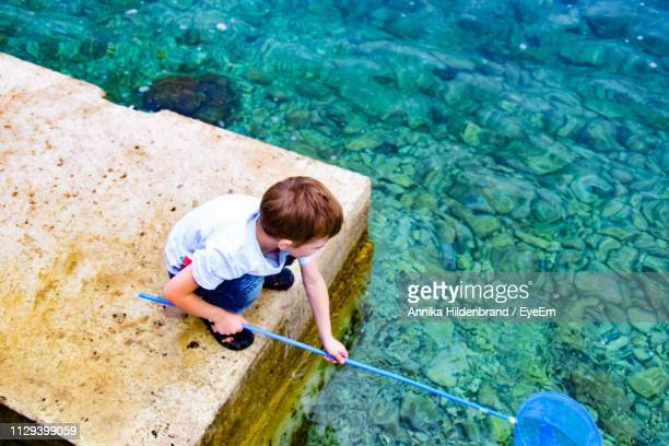 High Angle View Of Boy Fishing In