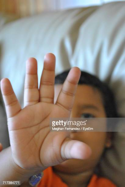 high angle view of boy gesturing while resting on sofa - meghan stock photos and pictures