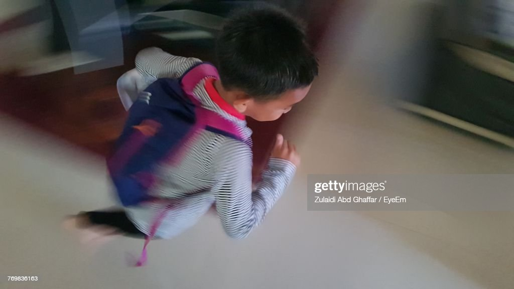 High Angle View Of Boy Playing Indoors : Stock Photo