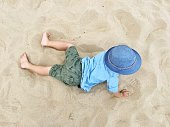 high angle view boy playing sand