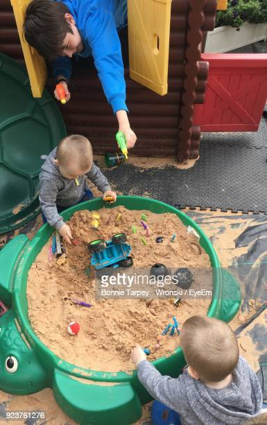 High Angle View Of Boys Playing With Toys
