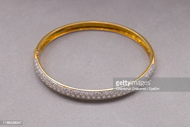 high angle view of bracelet on table - bracelet stock pictures, royalty-free photos & images