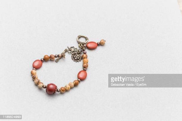 high angle view of bracelet on white background - bracelet stock pictures, royalty-free photos & images