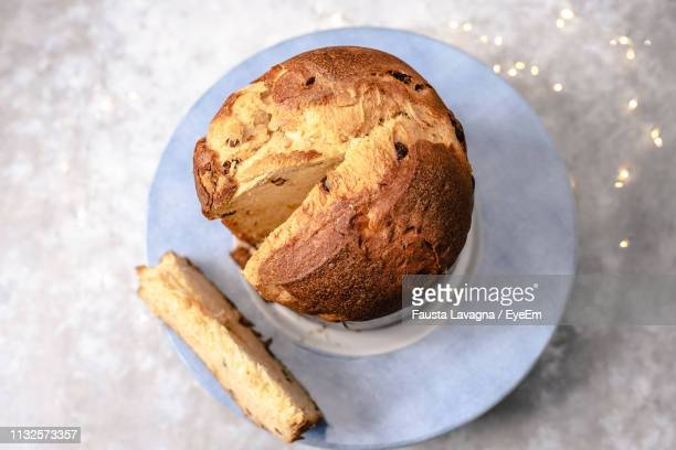 high angle view of bread in plate on table - panettone foto e immagini stock