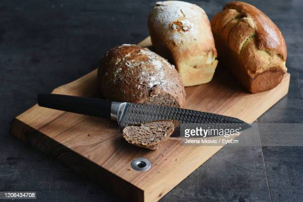 high angle view of bread on cutting board - jelena ivkovic stock pictures, royalty-free photos & images