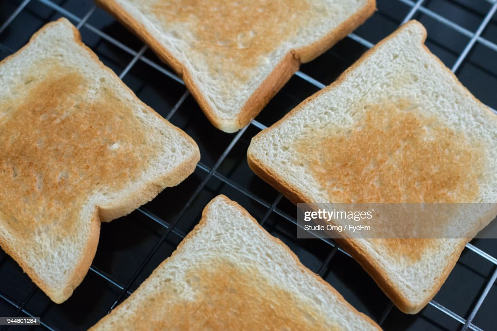 High Angle View Of Bread On Metal Grate : Stock Photo