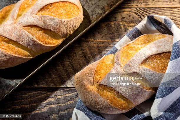 high angle view of bread on table,italia,italy - italia stock-fotos und bilder