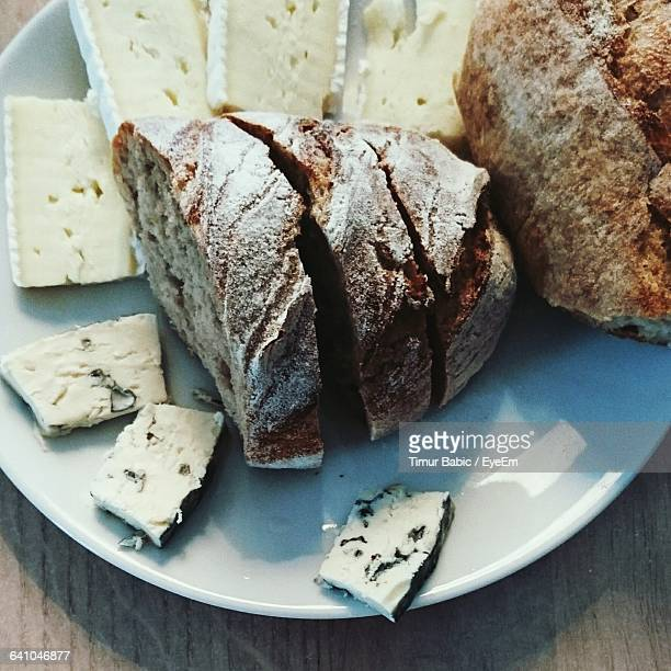 High Angle View Of Bread Slices And Gorgonzola In Plate