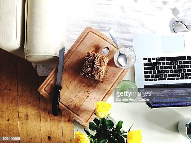 high angle view of bread with laptop on table at home - danielle reid stock pictures, royalty-free photos & images