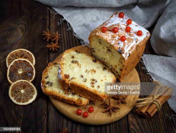 high angle view of breads and ingredients on cutting board - christmas cake stock photos and pictures
