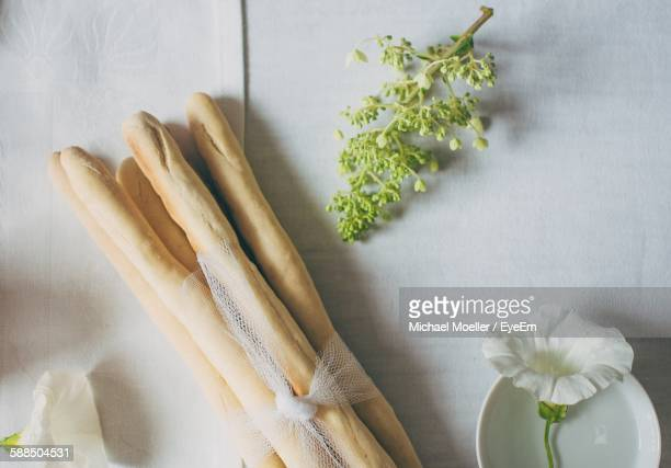 High Angle View Of Breadsticks On Wooden Table