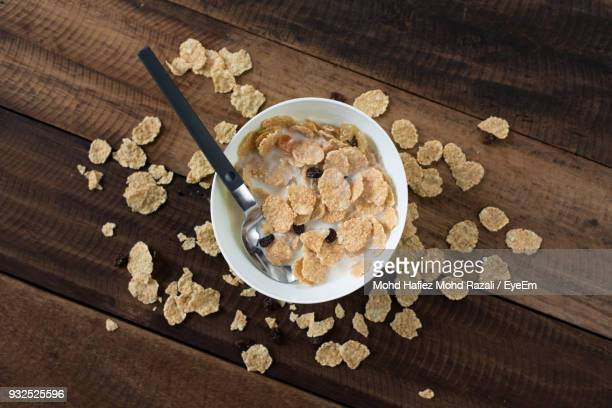 High Angle View Of Breakfast Cereal In Bowl On Wooden Table