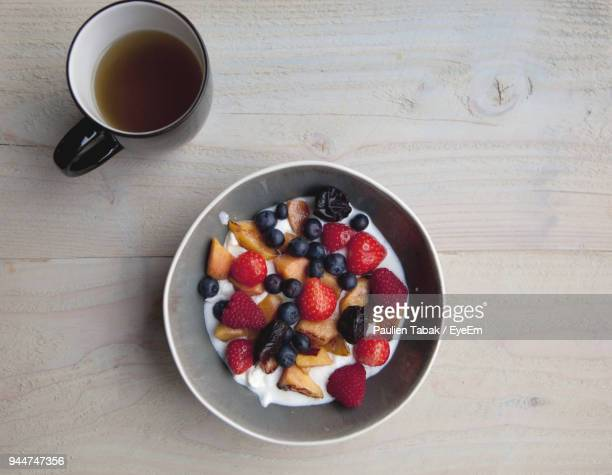 High Angle View Of Breakfast In Bowl By Tea On Table