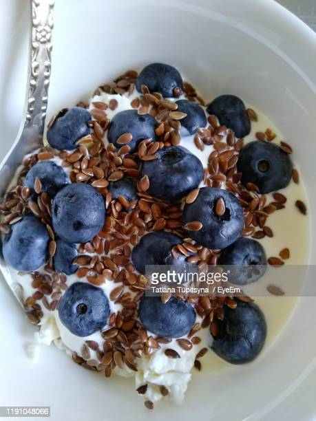 high angle view of breakfast in bowl - flax seed stock pictures, royalty-free photos & images