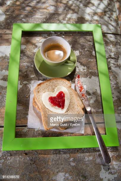 High Angle View Of Breakfast In Frame On Table