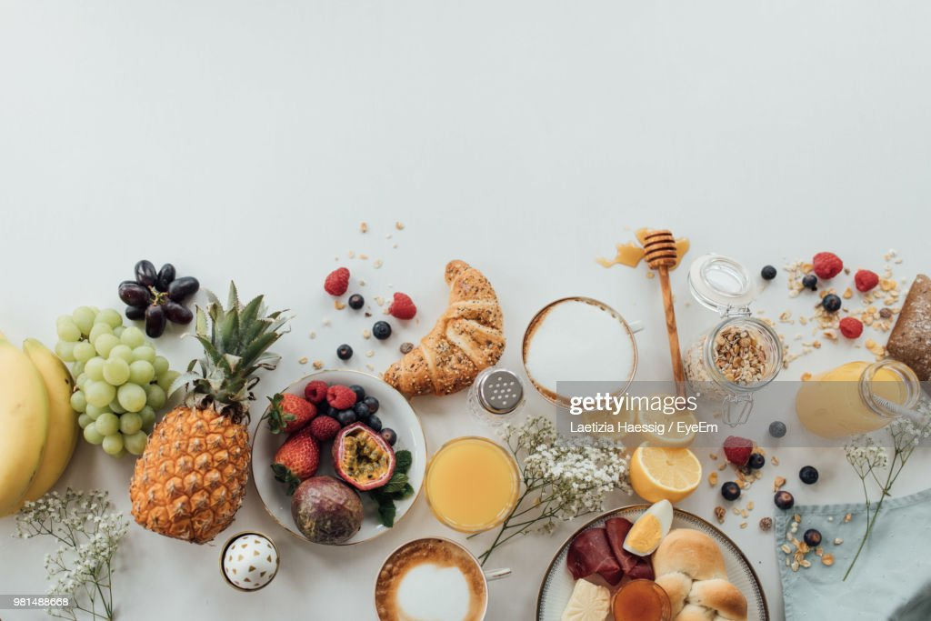High Angle View Of Breakfast On Table Against White Background : Stock-Foto