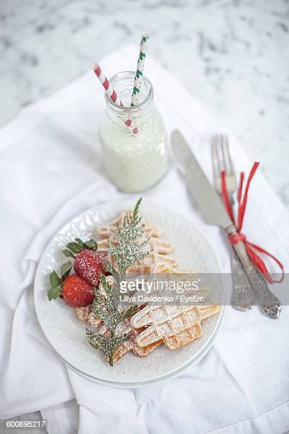 High Angle View Of Breakfast Served On Table During Christmas