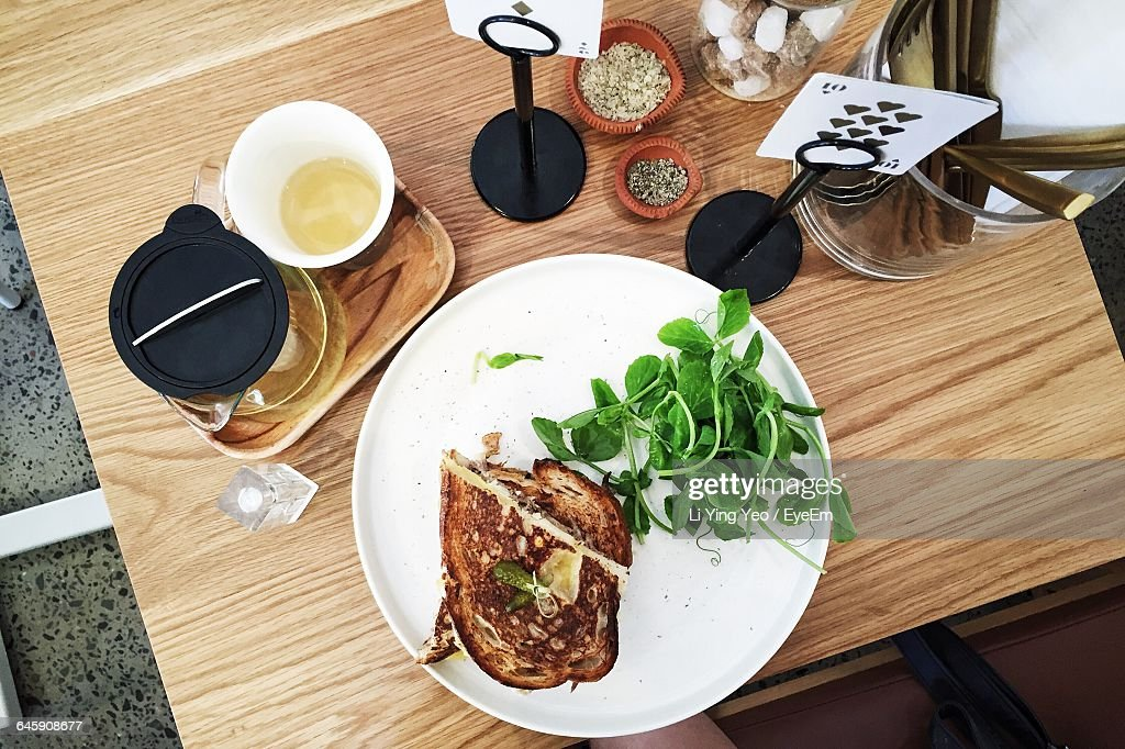 High Angle View Of Breakfast With Herbal Tea Served On Table : Stock Photo