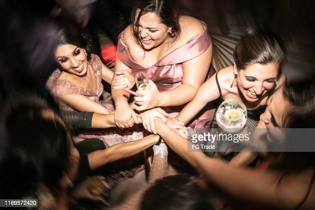 high angle view of bride and bridesmaid with hands together - wedding guest stock pictures, royalty-free photos & images