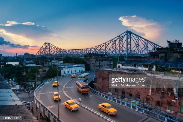 high angle view of bridge against sky in city - kolkata stock pictures, royalty-free photos & images