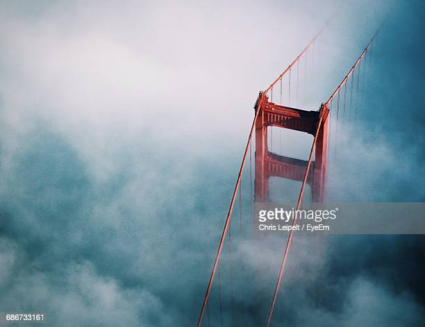 high angle view of bridge in clouds  - san francisco bridge fotografías e imágenes de stock