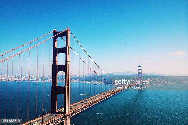 High Angle View Of Bridge Over Calm Blue Sea
