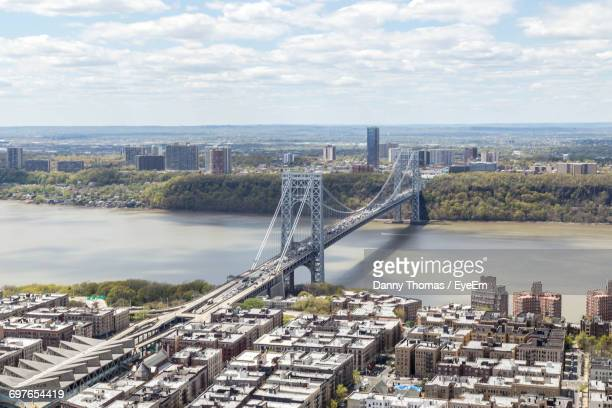 High Angle View Of Bridge Over River Against Cityscape