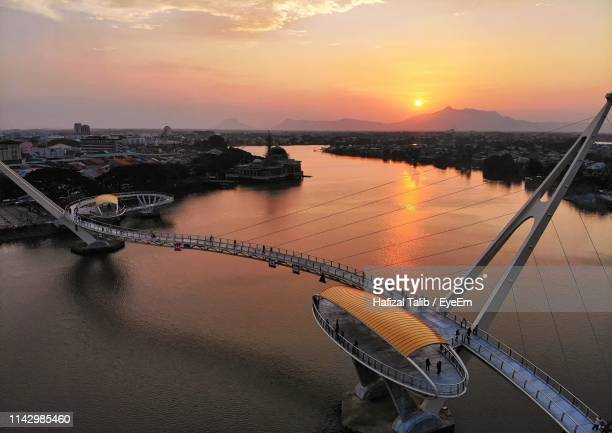 high angle view of bridge over river against sky during sunset - sarawak state stock pictures, royalty-free photos & images