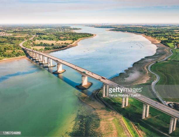 high angle view of bridge over river against sky - coastline stock pictures, royalty-free photos & images
