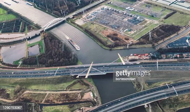 high angle view of bridge over river in city - bortes stock-fotos und bilder