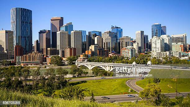 high angle view of bridge over roads by city - calgary stock pictures, royalty-free photos & images
