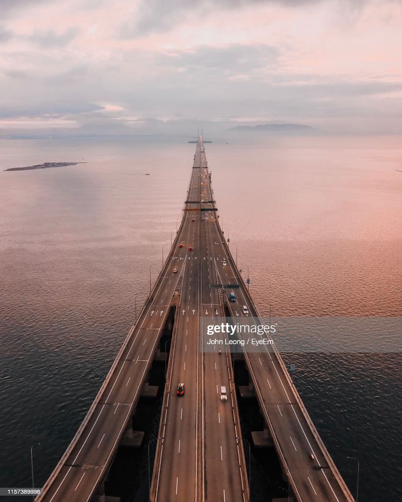 High Angle View Of Bridge Over Sea During Sunset : Stock Photo