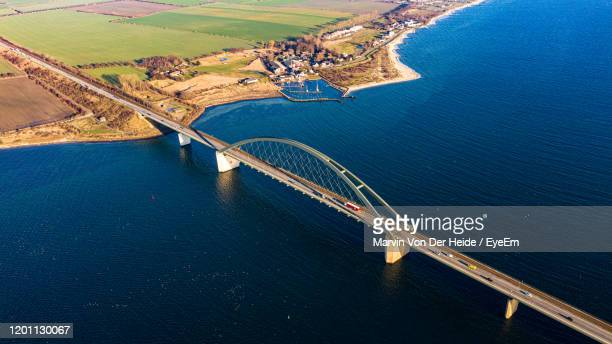 high angle view of bridge over sea - fehmarn stock-fotos und bilder
