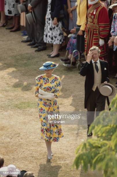 High angle view of British Royal Princess Alexandra of Kent and her husband British businessman Sir Angus Ogilvy attending the garden party, hosted...