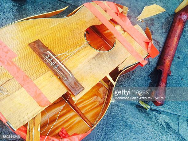 High Angle View Of Broken Acoustic Guitar