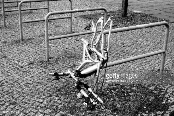 High Angle View Of Broken Bicycle On Rack In City