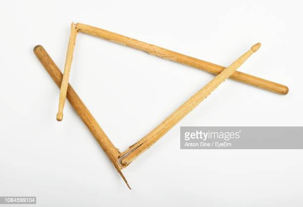 high angle view of broken drumsticks on white background - drumstick stock photos and pictures