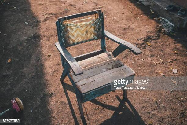 High Angle View Of Broken Empty Chair