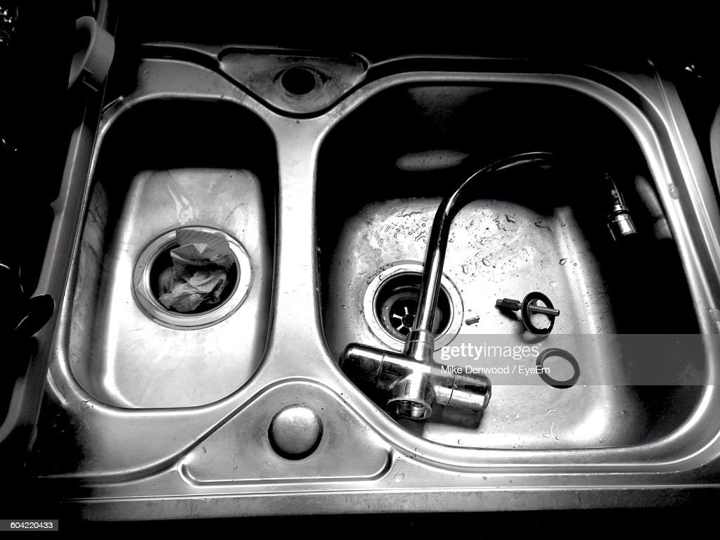 High Angle View Of Broken Faucet In Sink Stock Photo | Getty Images