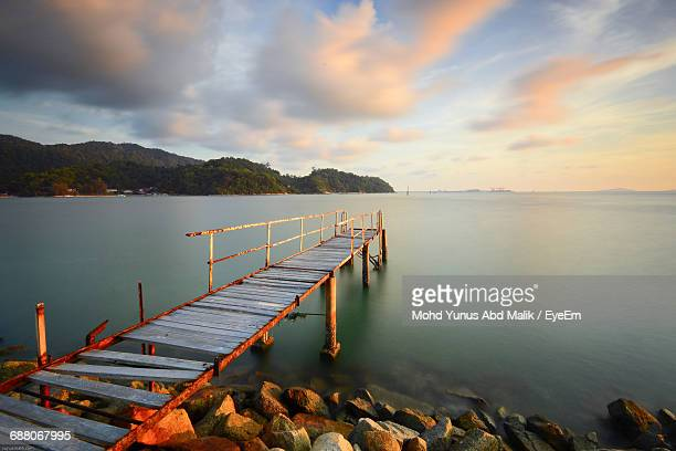 High Angle View Of Broken Pier Over Sea Against Sky