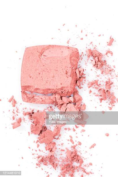 high angle view of broken pink cosmetic powde - アイメイク ストックフォトと画像