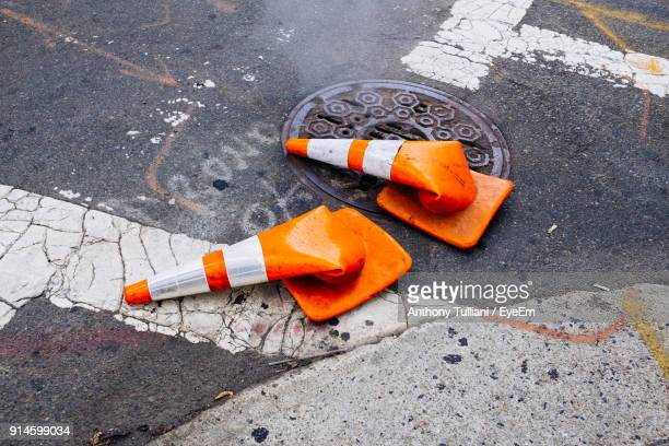 high angle view of broken traffic cones on road - traffic cone stock pictures, royalty-free photos & images