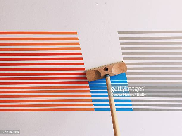 high angle view of broom on striped patterned floor - broom stock pictures, royalty-free photos & images