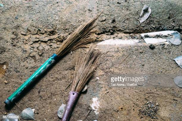 High Angle View Of Brooms On Ground