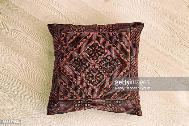 high angle view of brown cushion on table - cushion stock photos and pictures