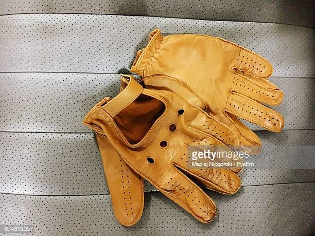 High Angle View Of Brown Leather Gloves On Car Seat