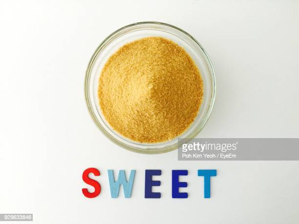 High Angle View Of Brown Sugar In Bowl Over White Background